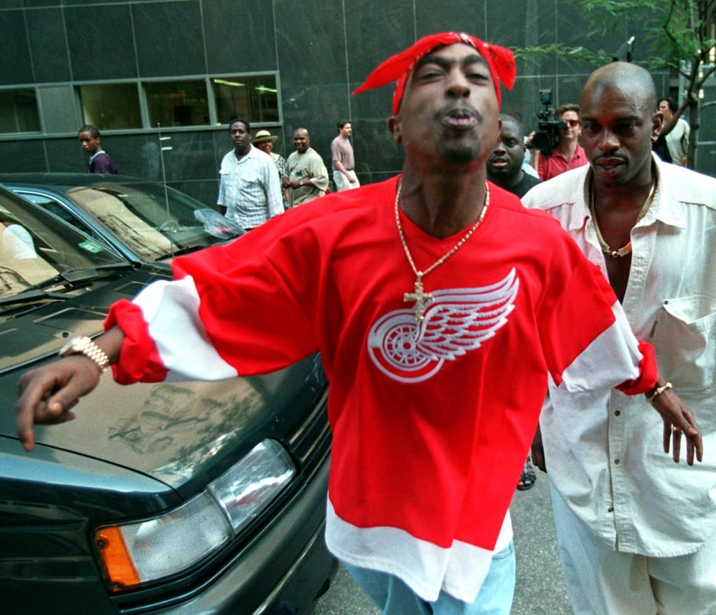 Tupac Shakur spits in the direction of reporters as he leaves state Supreme Court in New York, July 5, 1994 (AP Photo/Bebeto Matthews/FILE)