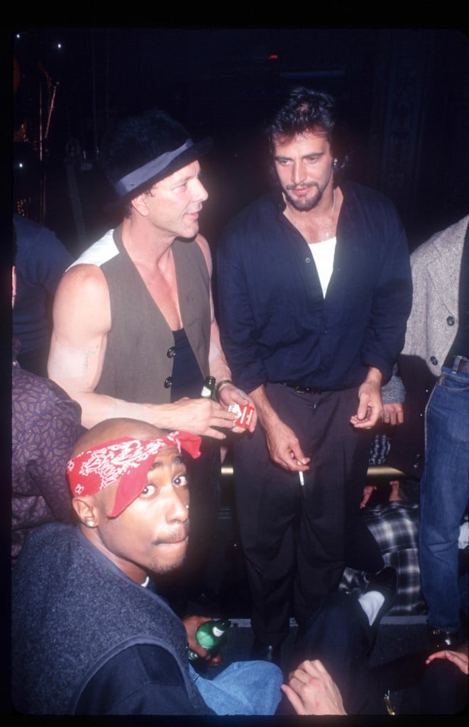201827 01: Rap artist Tupac Shakur and other celebrities attend a fashion show party on November 2, 1994 in New York City. (Photo by Arnaldo Magnani/Liaison)